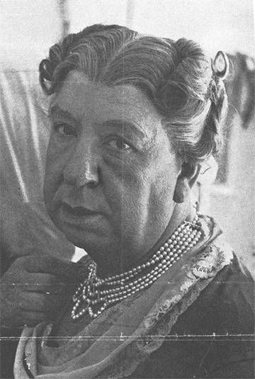 Alfred Hitchcock Poses in Drag for a Magazine