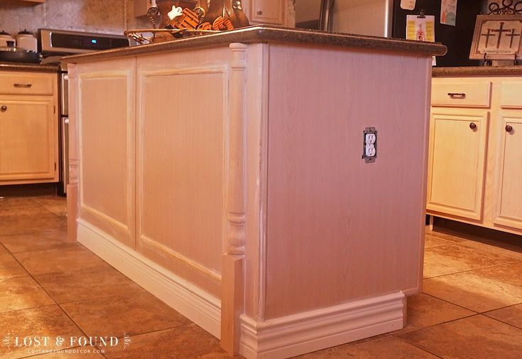 "Builder-Grade Kitchen Island Upgrade: I enjoyed adding some ""umph"" to an otherwise boring, builder-grade, kitchen island. See the step by step here!"