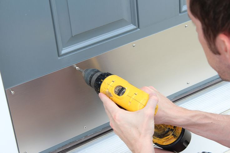 Add a kick plate to dress up the front door.