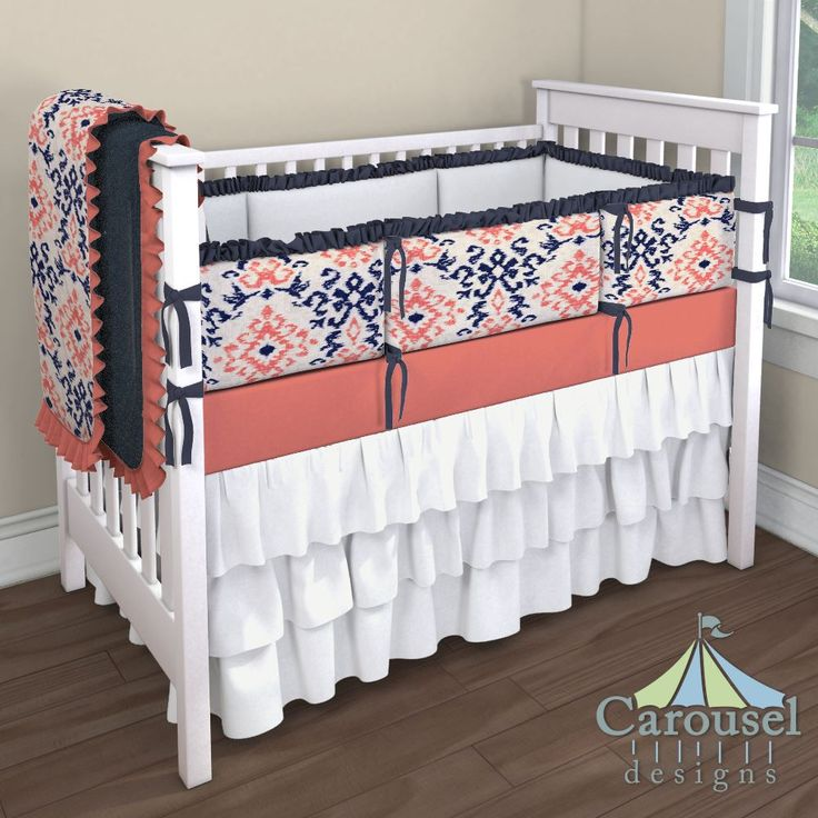 Crib bedding in Solid Antique White, Solid Navy Minky, Navy and Coral Ikat Damask, Solid Coral, Solid Navy. Created using the Nursery Designer® by Carousel Designs where you mix and match from hundreds of fabrics to create your own unique baby bedding. #carouseldesigns