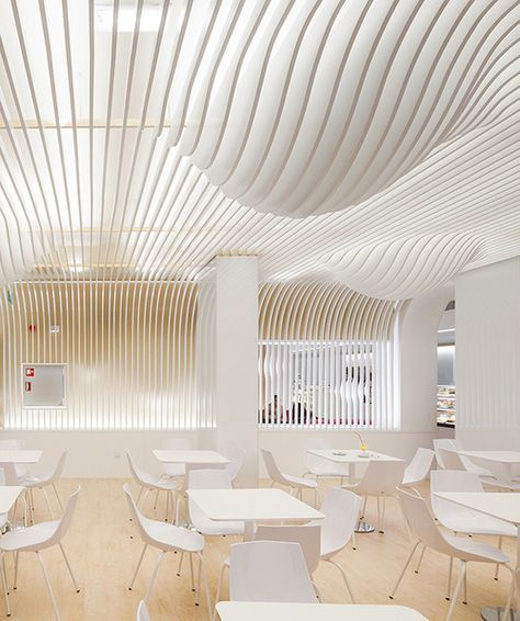 Beautiful cafeteria, wood flooring and white furnitur. Moder and minimalist design.| By Paulo Berlini. Oporto, Portugal