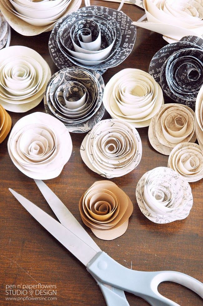 DIY Paper Flowers - so easy and so pretty! Versatile for so many different things: home decor, party decor, gift packaging and more! #paperflowers #diyhomedecor #partydecorations #papercrafts #giftwrapidea