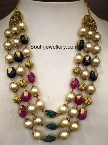 Three line beads mala strung with south sea pearls, nakshi balls, ruby beads, emerald beads and sapphire beads by Premraj Shantilal jewellers.