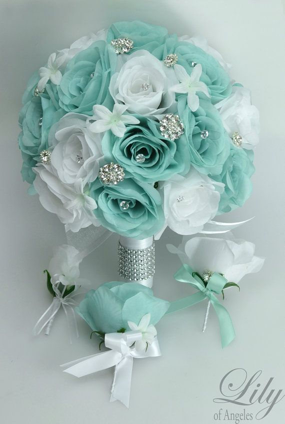 If You Need Different Quantities or Colors Please Contact Us. ---- Model: TIWT01 You are buying a 17 piece package including:  1 Brides round bouquet (10 round) Robin's Egg blue and white open Roses accented with white Stephanotis decorated with faux jewelries and diamonds. The handle is wrapped in white satin ribbon decorated with rhinestone cuff and white bow & tails. (Thick handle)  1 Maid of Honor bouquet (9 round) Robin's Egg blue and white open Roses accented with white Stephanotis ...