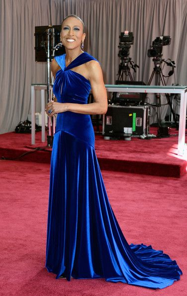 #oscarfashion 2013 At the Oscars one year ago, Good Morning America co-host Robin Roberts started to feel the symptoms of a blood disorder called MDS. At the show this time around, the gorgeous TV personality walked the red carpet in a stunning cobalt blue Marc Bouwer gown — her first since her bone marrow transplant in late 2012.     Roberts, rocking her shaved head, looked radiant at the show and caught the attention of many fans and followers at the big event.