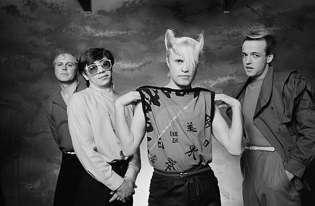 English pop group A Flock Of Seagulls posed in a studio in London in November 1982 Left to Right Ali Score Paul Reynolds Mike Score Frank Maudsley