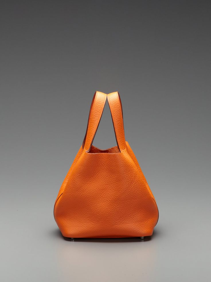 I have this bag in light blue! I'll never have a Birkin, but I have an Hermes. =)