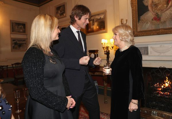 Camilla, Duchess of Cornwall (R) with Equestrians Gemma Tattersall (L) and William Fox Pitt during a reception for the British Equestrian teams who took part in the 2016 Olympic and Paralympic games at Clarence House on January 24, 2017 in London, England.