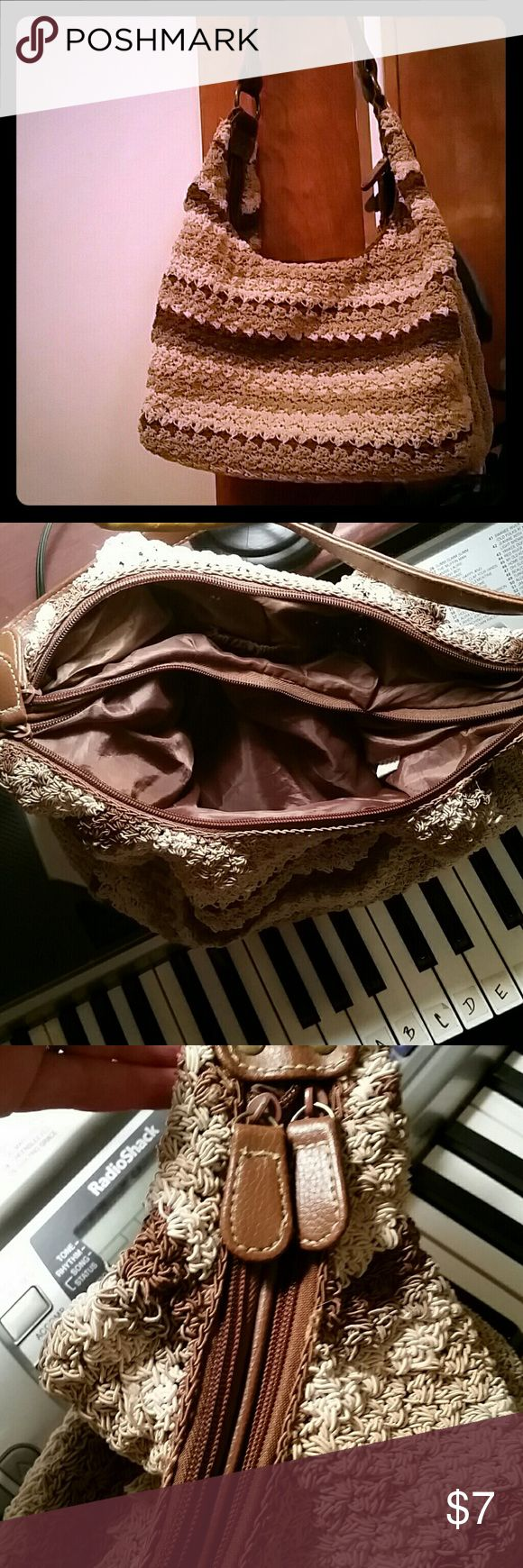 Spacious and Versatile Shoulder Bag No brand, brown, tan, and cream purse.  Double zipper with compartments on each side and other small pockets.  Neutral color, should go well with lots of outfits.  There are a few loose strings, as shown in the last pic, but barely noticeable. No Brand Bags Shoulder Bags