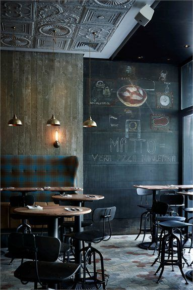 geometric forms at ceiling | copper plated lighting | plaid textiles | matte black + vertical wood panel wall