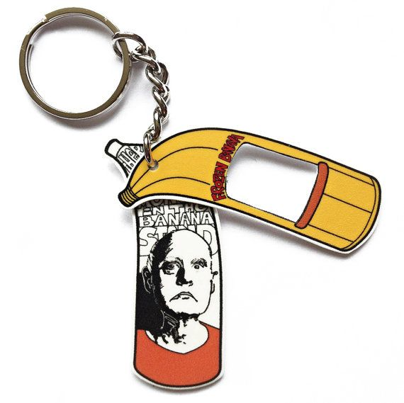 The Banana Stand Keychain - There is always money Banana Stand. Unfortunately, no one listened and the money went up in smoke... AND THATS WHY you should always listen to George Bluth, Sr.! Unless he tries to sell you a Cornballer.  This is our Banana Stand Keychain design inspired by the character of George Bluth, Sr. The The Banana Stand Keychain is made of shrink plastic attached to a very sturdy metal keychain ring. The colors are black, yellow, orange, red and white but please note…