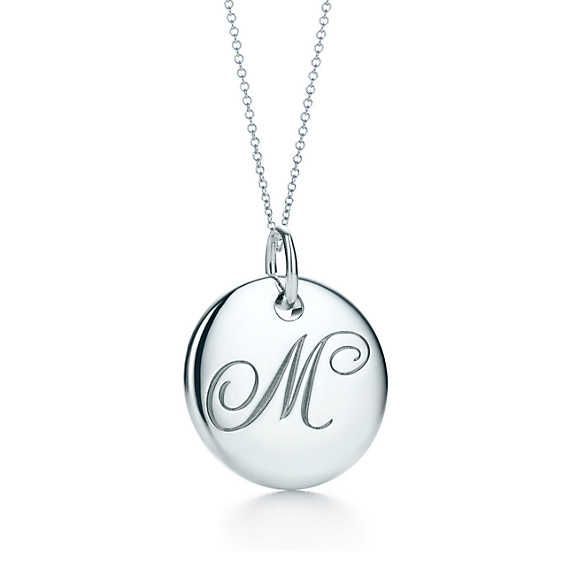 Tiffany Notes alphabet disc charm in silver on a chain. Letters A-Z available.