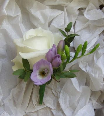 Groom's Boutonniere of rose, lilac freesia, and eucalyptus. Fiori by Lynne. Wedding Flowers Blog: Colours Purple lilac Ivory