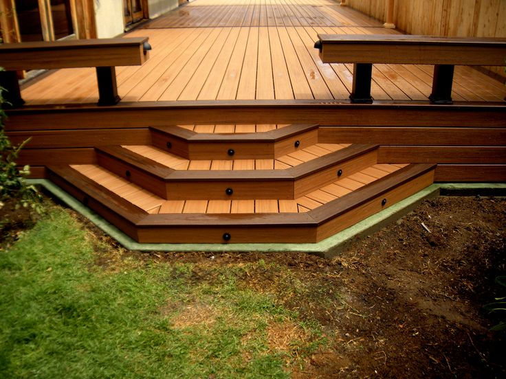 Trex Deck With Custom Steps And Green Concrete Curb To