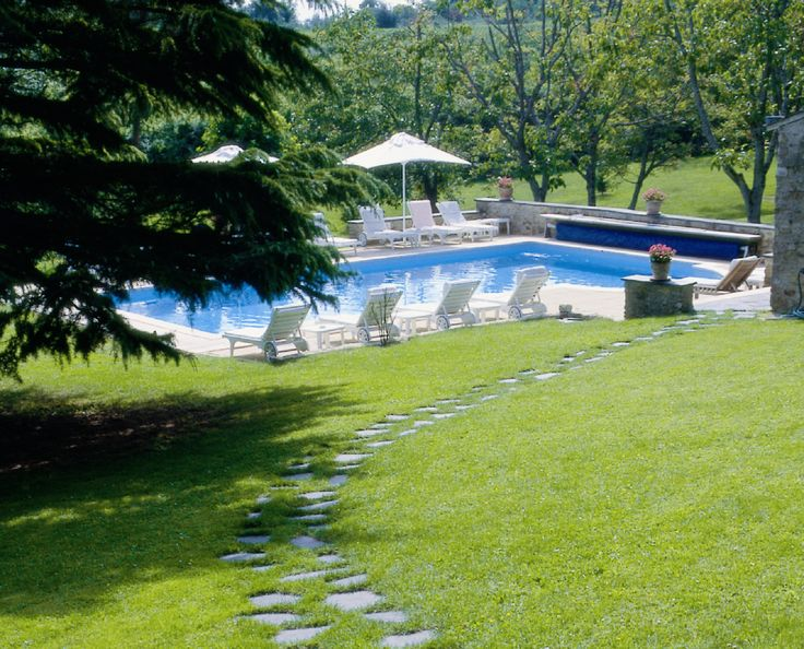 The grassy outdoor swimming pool or 'la piscine' at Chateau de Noirieux in the Loire Valley #swimmingpool #garden #France #hotel #luxury