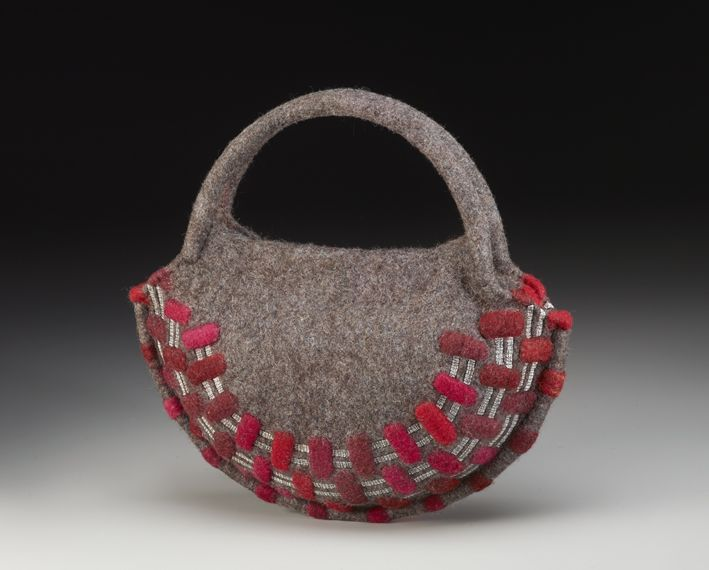 """Tracks, HB152 2014 13"""" x 13"""" x 4"""" icelandic, alpaca & merino wool fiber, silk fiber, cotton & waxed linen thread, tubing, magnetic closure, shellac; naturally dyed with cochineal & osage natural dyes, wet felted hollow form, partial felt surface patterned, free-motion machine embroidered, hand stitched photo credit: Steve Mann $1250"""