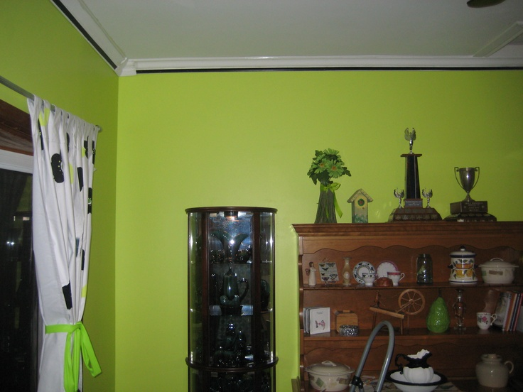I painted the kitchen a bright green.So refreshing and bright.We adding crown molding and I painted a black stripe to give it some pop.