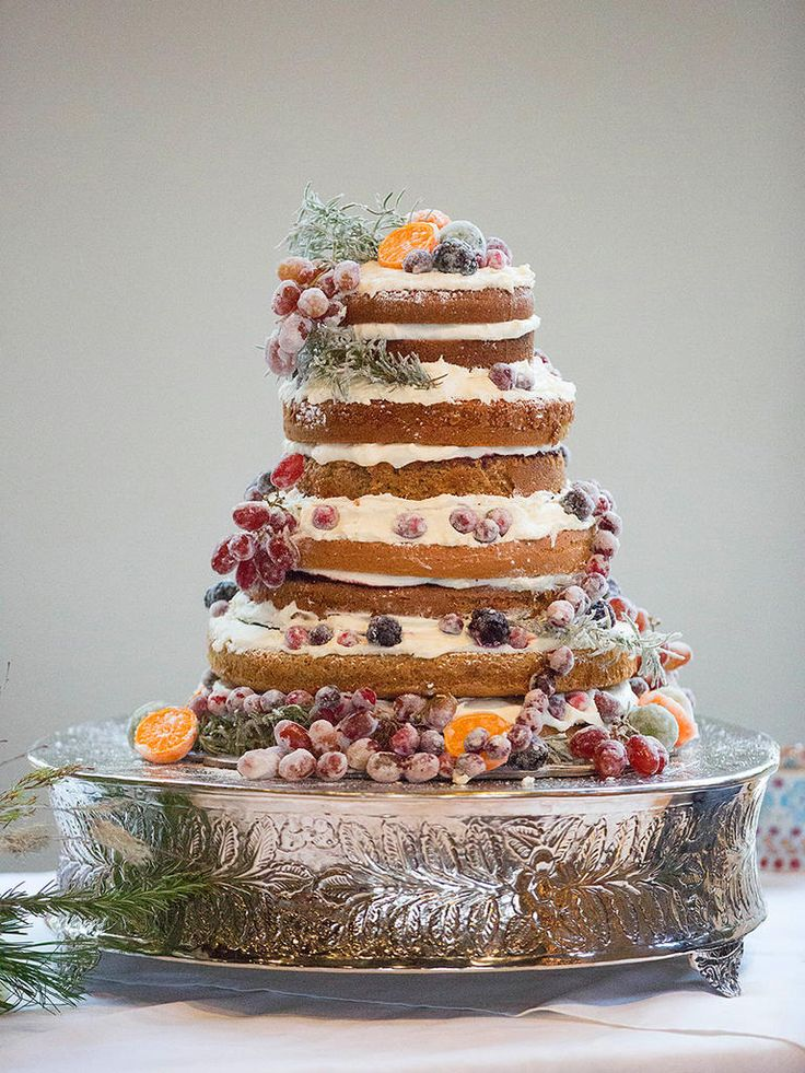 Naked wedding cakes are in! Take yours to the next level by adding sugar-dusted fruit garnishes.