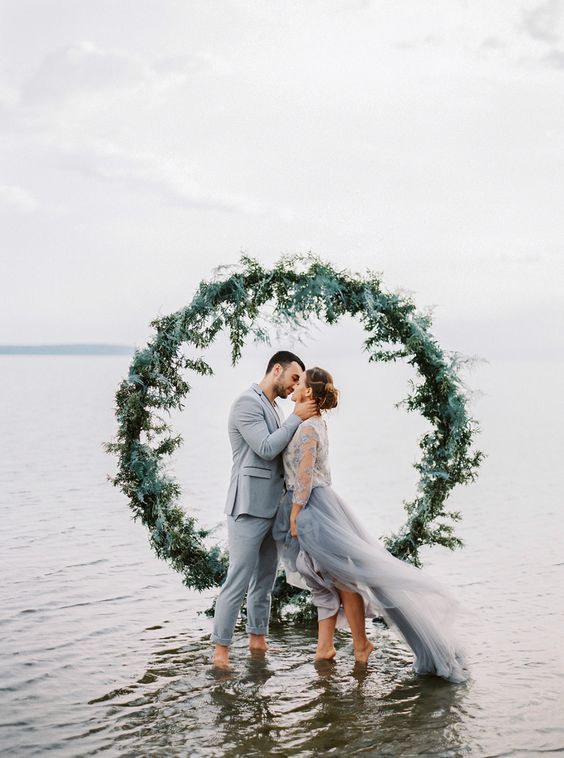Greenery wedding arch via Muravnik Photography / http://www.deerpearlflowers.com/wedding-ceremony-arches-and-altars/4/