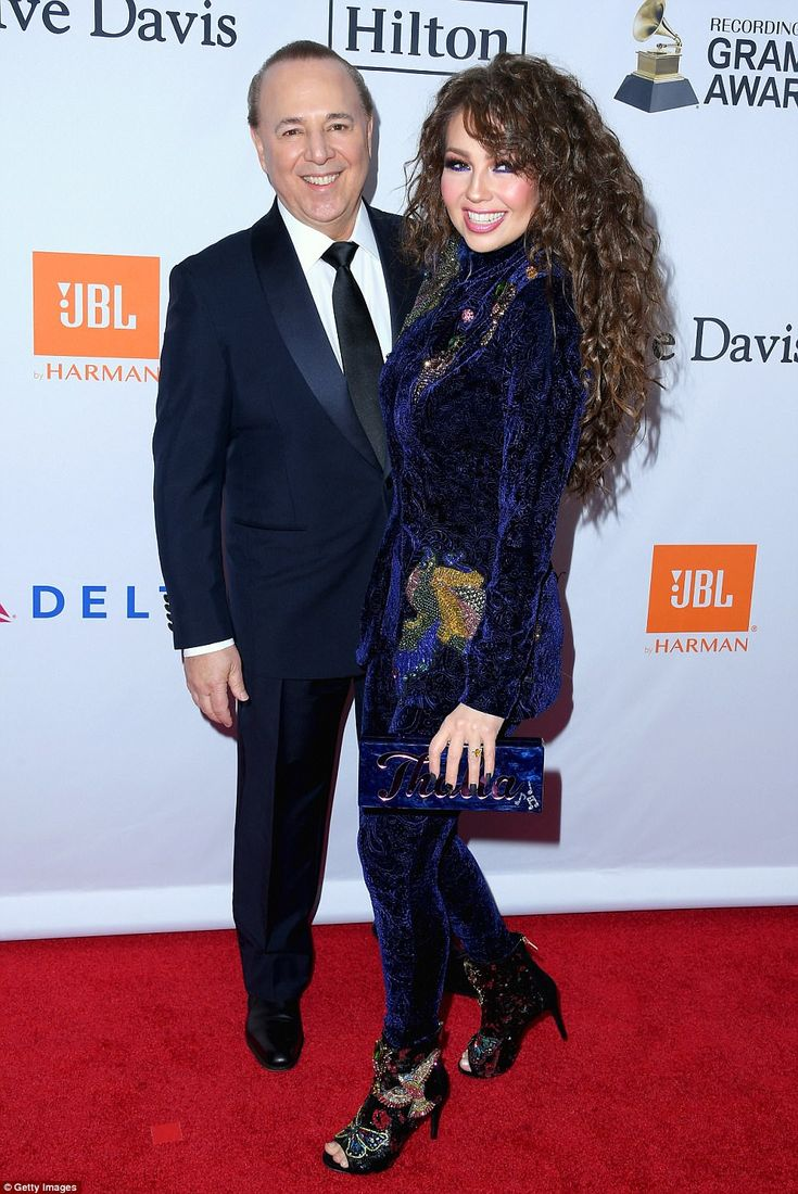 Third time's a charm: Casablanca Records co-owner Tommy Mottola, who is 68 and used to be married to Mariah Carey, arrived on the arm of his third and current wife Thalia, who is 46 and married him in 2000