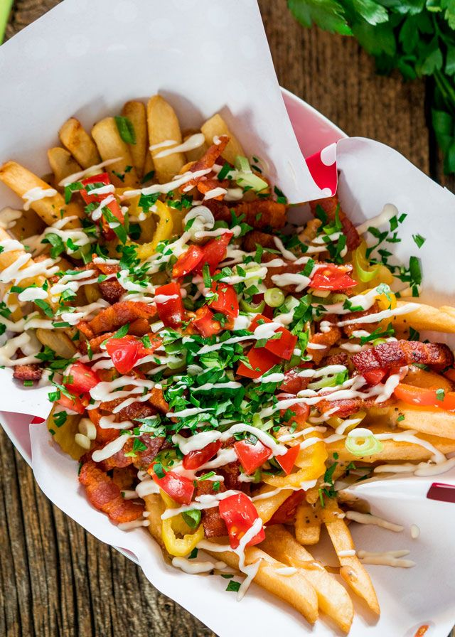 This recipe for dirty fries will rock your world! They're loaded with homemade gravy, bacon, banana peppers, green onions, tomatoes, parsley, and drizzled with mayonnaise. Serve up on Game Day for an appetizer that will wow your taste buds.