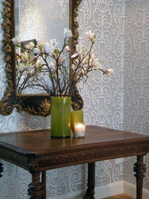 Metallic wallpaper by Osborne and Little bounces light into a dark hallway.  Interior Design by Room Service Interiors.