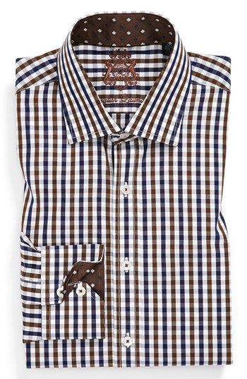 English Laundry dress shirts at Nordstrom are designed for a comfortable fit. Generously cut across the chest and shoulders, they are finished with relaxed armholes and sleeves.