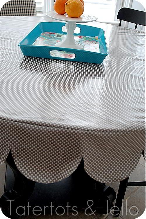 Make a super durable tablecloth out of laminated fabric. It wipes off easily and looks great all the time. I'm sharing a tutorial on how to make a tailored, sleek tablecloth with a scalloped skirt. If I can make it, you can too!