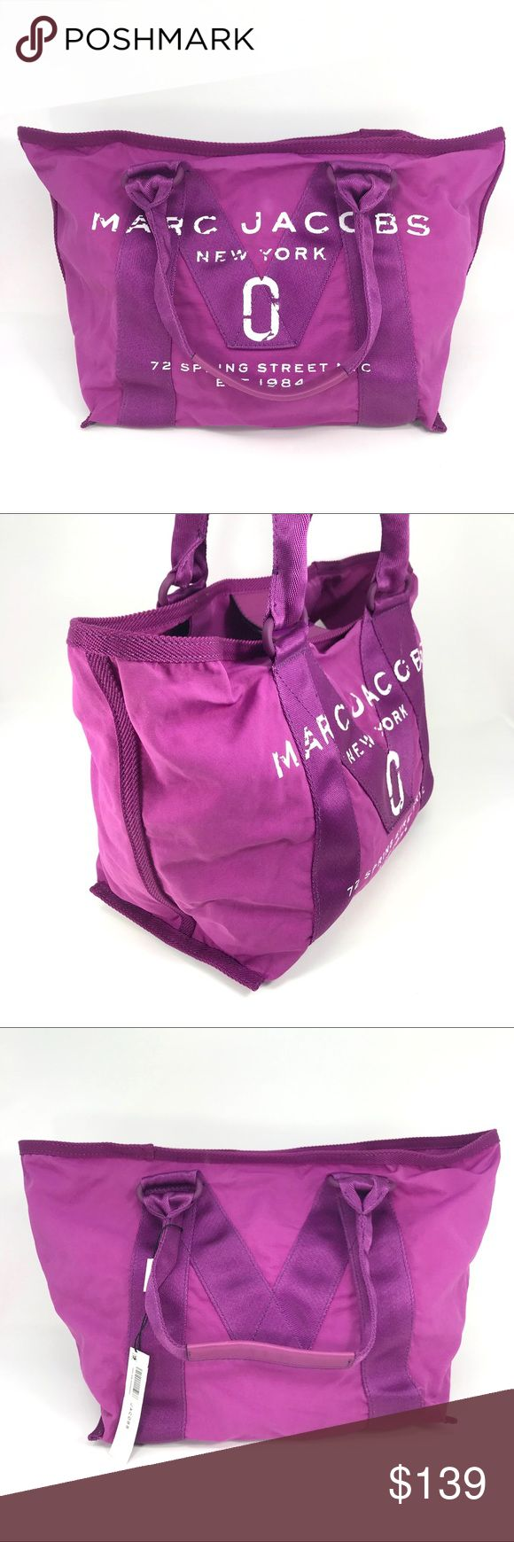 """NWT Marc Jacobs New Logo Canvas Lilac Tote Bag This bright purple tote bag from Marc Jacobs is the perfect accessory for a busy lifestyle, as a shopper or gym bag.  Marc Jacobs  100% authentic  Condition: brand new with tags  Retail: $198 plus tax  Tote bag  Color: lilac purple  Material: cotton nylon / leather trim  Double handles Velcro tab closure Unlined Two interior zip pockets Oversized logo graphic on front  Approximate Measurements: Length: 19"""" Height: 11.5"""" Width: 6.75"""" Strap: 10.6""""…"""