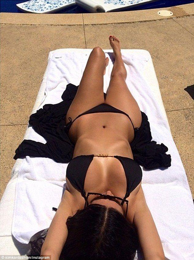Kim Kardashian shared stunning bikini snaps from Puerto Vallarta, where she and Kanye West honeymooned in June http://dailym.ai/1lr9axQ