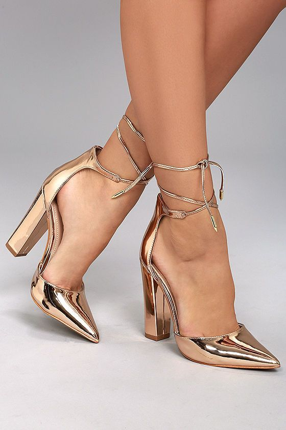 Befriending everyone she meets, the Angela Rose Gold Lace-Up Heels are undoubtedly irresistible! Metallic vegan leather covers the pointed toe upper of these sexy pumps, and continues into the structured heel cup with long, tying laces (and gold aglets).