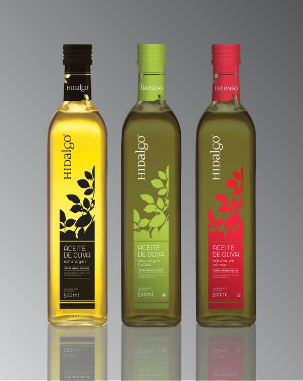 Rebranding and new packaging system for Hidalgo  by IDD Identidad y Diseño  La identidad se puede conseguir manteniendo un elemento significativo, en este caso la botella y la forma de la etiqueta. Varía el color que lo hace también con el contenido.