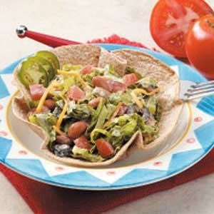 Vegetarian Taco Salad Recipe -The cute tortilla bowls that hold this Southwestern salad are a snap to bake int the oven. We use canned beans that include hot spices to punch up the flavor. —Susan LeBrun of Sulphur, Louisiana