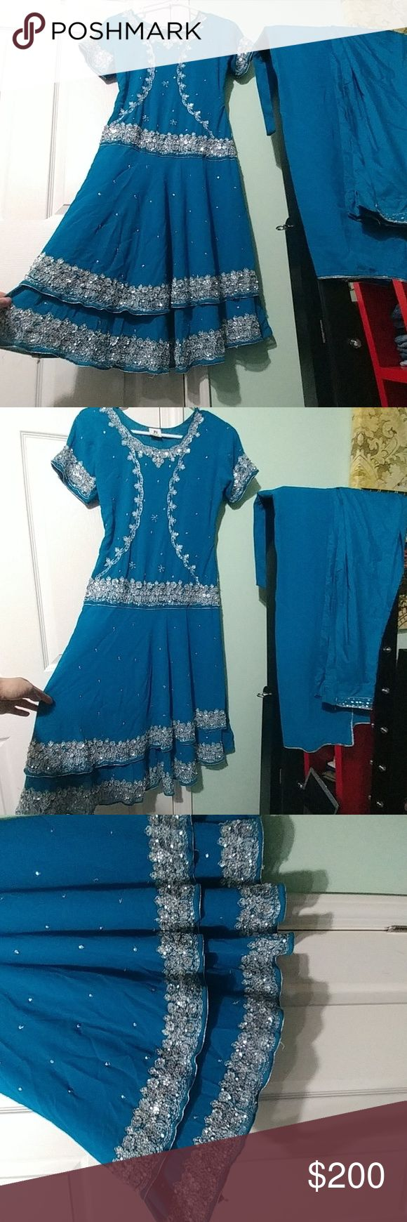 Indian/Pakistani dress with silver work size small Size small Includes top, pants and scarf  Worn a few times but overall like new condition. The only flaw is shown in 2 photos. One loop got undone and needs to be sewn back on - easy fix. Save today! Dresses Midi