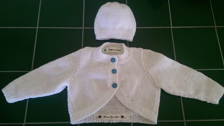 White hand knitted baby cardigan and hat