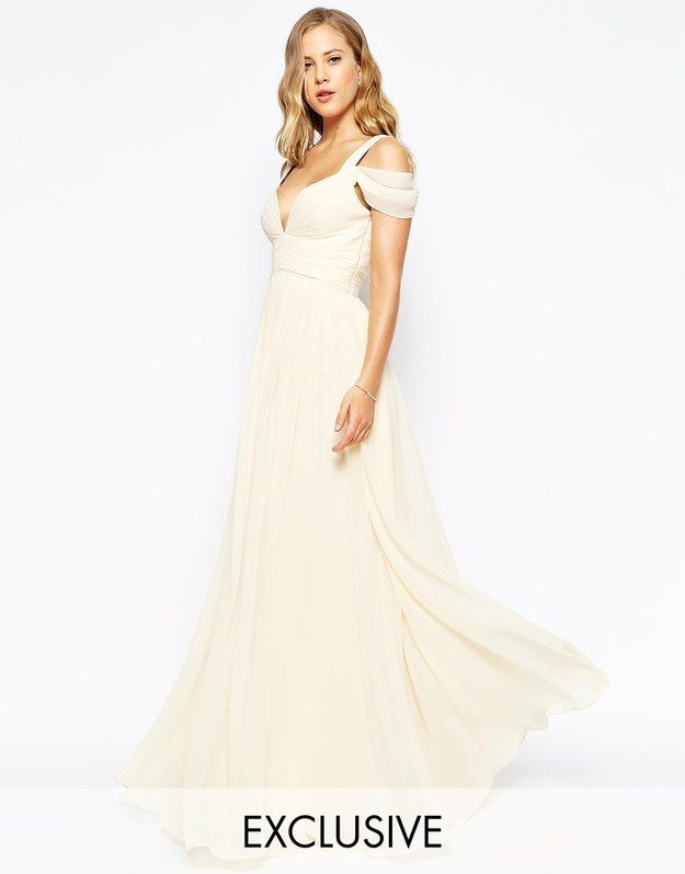This Forever Unique sweetheart maxi dress, $336. | 33 Impossibly Pretty Wedding Dresses With Sleeves. It would look better without the thing past the shoulder.