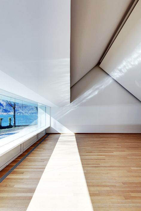 The reflective metallic sill in ACT Romegialli's rower's hall in Mandello Lario generates some stunning lighting patterns throughout the day; a rippled effect similar to the adjacent river the rowers practice on. Via.