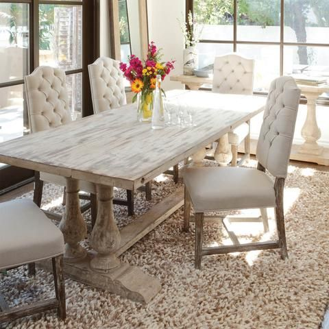 The transitional Windsor Dining Table is fabricated from reclaimed pine wood and finished by hand. The natural cracks and knots that are inherent to salvaged wood have been preserved to add a touch of