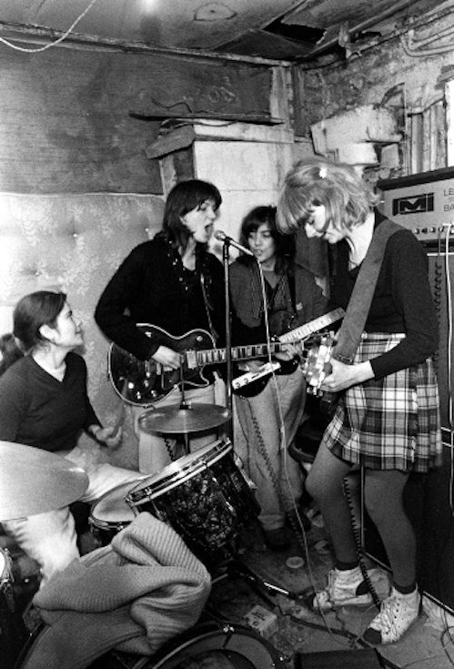 The Raincoats, London, 1979 (Janette Beckman) The Raincoats are a British post-punk band. Ana da Silva (vocals, guitar) and Gina Birch (vocals, bass) formed the group in 1977 while they were students at Hornsey College of Art, London, England.[1] The line-up included Ross Crighton on guitar and Nick Turner on drums for the band's first gig on 9 November 1977. Kate Korus, from The Slits and later The Mo-dettes, joined briefly but was replaced by Jeremie Frank. Nick Turner left to f