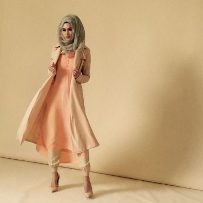 Pintuck Peach Kurti paired with Sun Kissed Chiffon Silk Hijab and Beige Ankle Grip Trousers.
