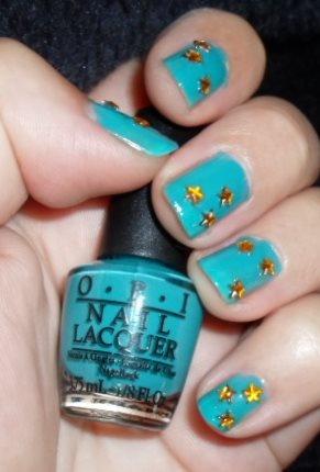 Gold rhinestones on turquoise background.