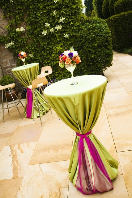 Wine glasses as centerpiece! Table cloths with ribbon in wedding colors (blue and green) or white