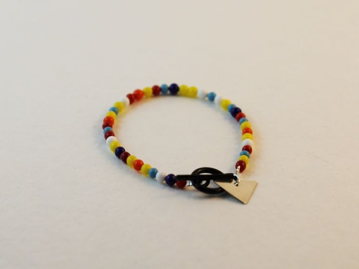 These beads were a gift brought back from Venice. This bracelet also features a hand cut sterling silver charm. So colourful and cute!