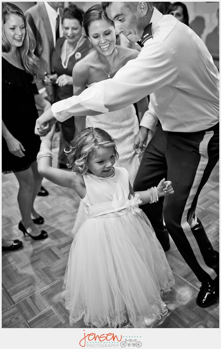 This is the sweetest photo (bride watches while groom dances with the flower girl)