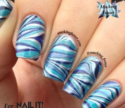 Hanukkah water marble nails by Corynn Musser, muckingfusser | NailIt! Magazine