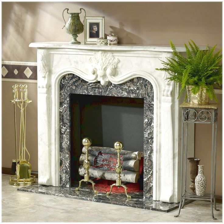 GET AN ATTRACTIVE LOOK WITH FIREPLACE MANTEL WITH ORNATE FIREPLACE WHICH HAS A GOLD URN