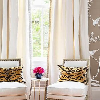French Slipper Chairs with Tiger Print Pillows and Gray Greek Key Curtains