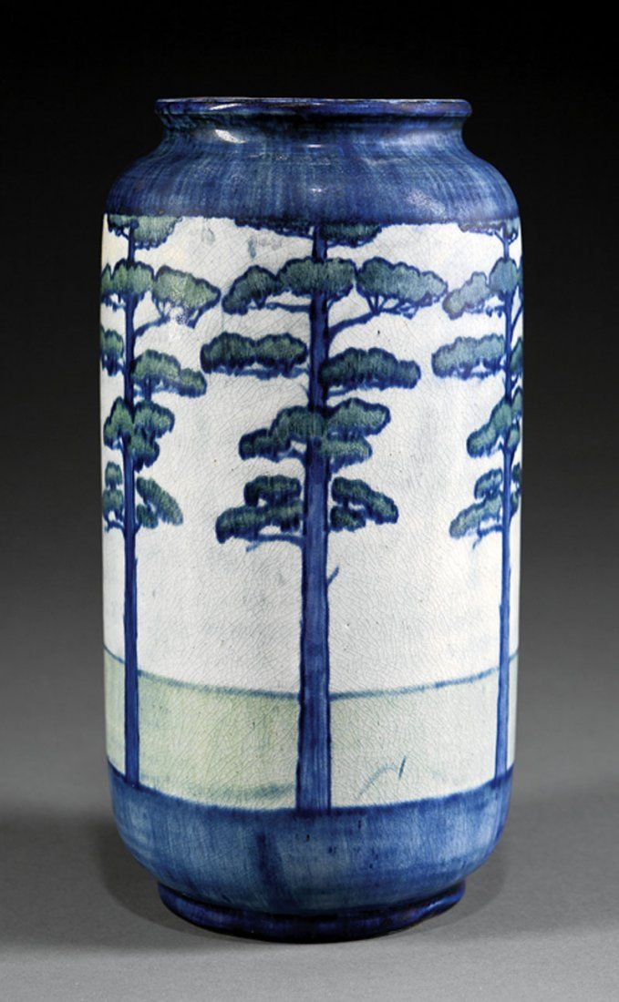 A Newcomb College Art Pottery Vase, 1902, decorated by Desiree Roman with a repeating pattern of tall pine trees, high glaze with blue and green underglaze, base marked with Newcomb cipher, decorator's mark, Joseph Meyer's potter's mark, reg. no. P43, and U for buff clay body, height 9 1/2 in