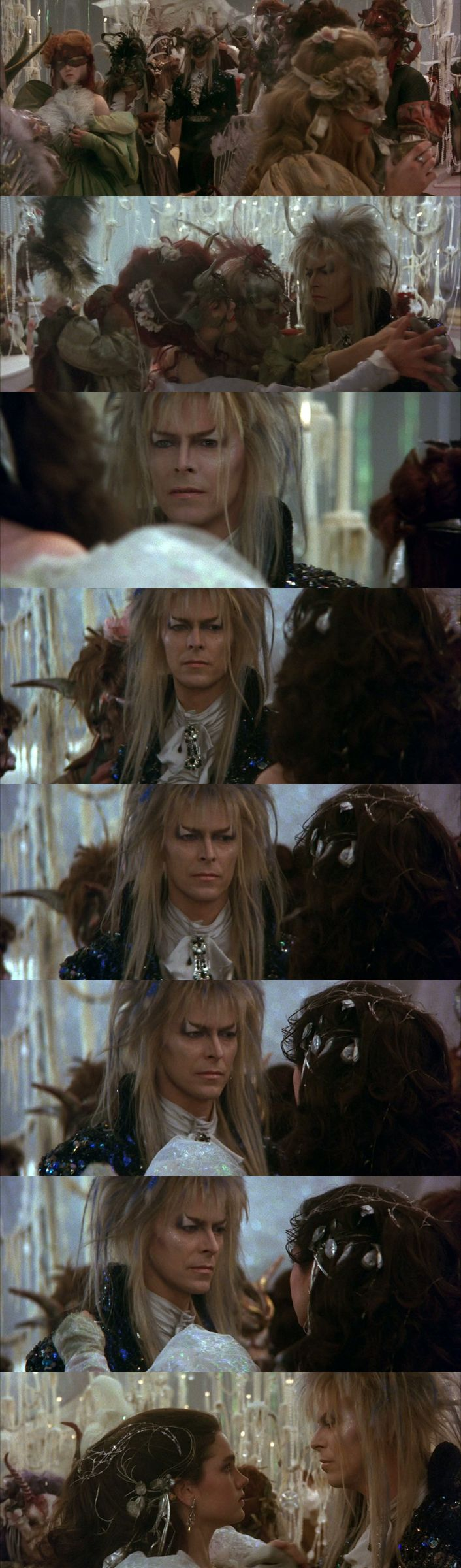"Labyrinth (1986): Sarah (Jennifer Connelly) and Jareth, the Goblin King (David Bowie), dancing in the ball scene on the music ""As the world falls down"" (sung by David Bowie)."