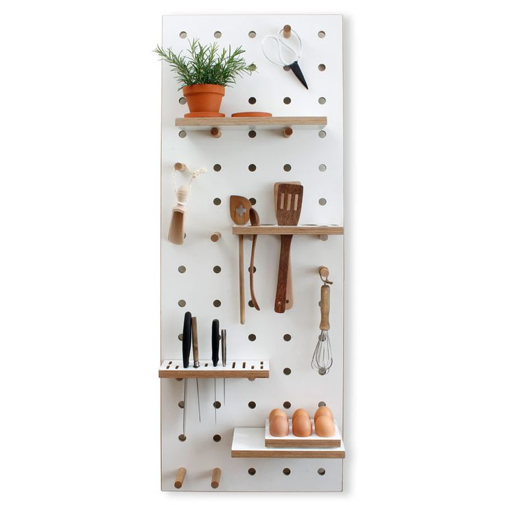 Chef's Edition Peg Board by Kreisdesign. this solid, chunky, beautifully handmade peg board is so clever. It has specially made slots for knives and utensils, shelves for holding pots and spices and pegs for hanging tea towels, scissors and utensils. Great for decluttering your kitchen, adding extra storage and brilliant for a modern Scandinavian style kitchen.